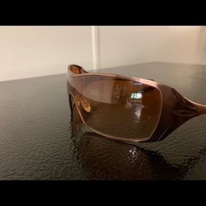 Oakley Dart Sunglasses In rose gold.